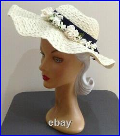 1940s'CREAMY WHITE' Wavy Wide Brimed Hat, Enhanced by Tiny Florals on Navy Band